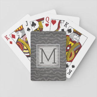 Det gråa svart tavlahav vinkar med monogramen spel kort