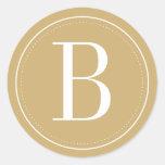 Det guld- Monogramkuvertet förseglar Runt Klistermärke