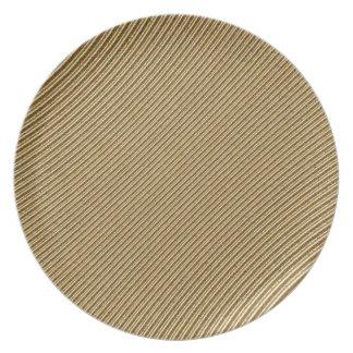 Det guld- stripy mönster pläterar tallrik