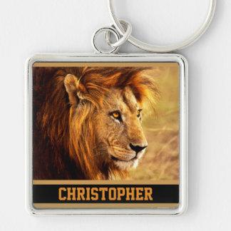 Det nobla lejont fotograferar fyrkantig silverfärgad nyckelring