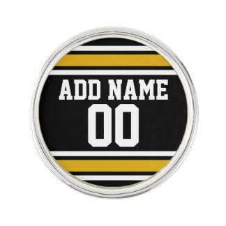 Det svart guld- namn för den fotbollJersey Kavajnål