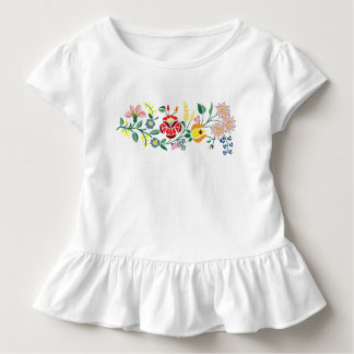 Det traditionella blommabroderismåbarn rufsar t shirts