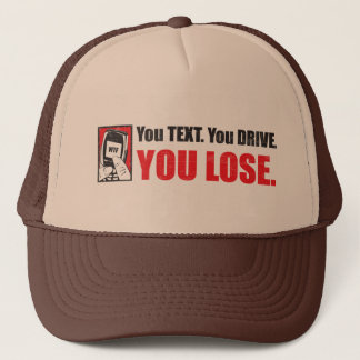 Dig text. Du kör. Du förlorar.  Hatt Keps