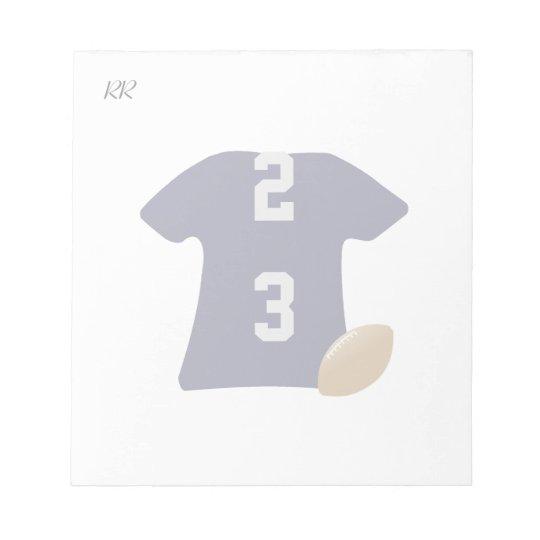 Din fotbollskjorta med boll på den små anteckningsblock