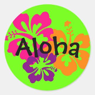 Djärva och ljusa hawaianska blommor runt klistermärke