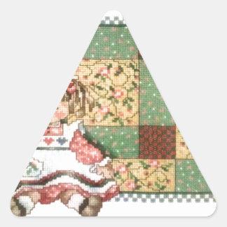 Docka med täcket triangelformat klistermärke