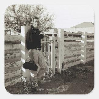 Doktoranseende vid ett staket fyrkantigt klistermärke