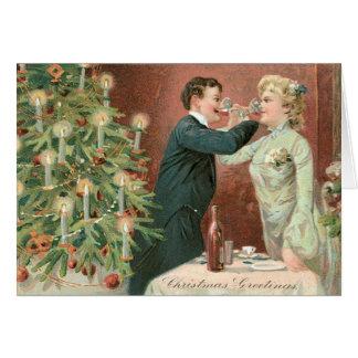 Dricka vin nära julgranen hälsningskort