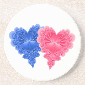 Dubbla hjärtor i rosor och blått underlägg sandsten