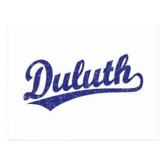 Duluth skrivar logotypen i blått vykort