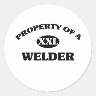 Egendom av en WELDER Runt Klistermärke