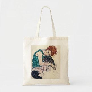 Egon hänger lös den Schiele placerade kvinnatotot Tygkasse