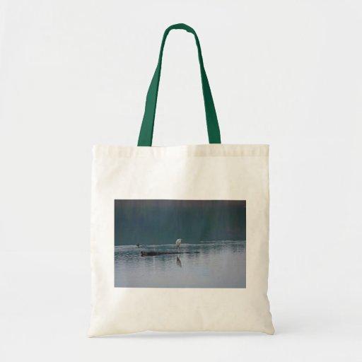 Egreten på totot för sjöfotokanfas hänger lös tygkassar