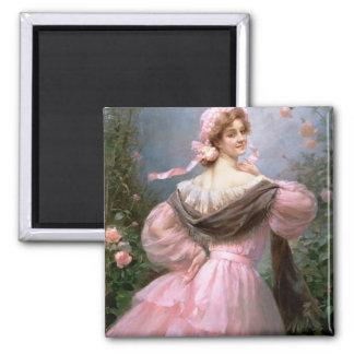 Elegant kvinna i en roträdgård magnet