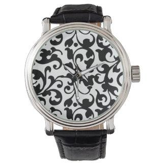 Elegant svartvit vintagerulladamast armbandsur