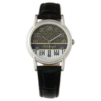 Eleganta pianonycklar med guld- Quatrefoil på Armbandsur