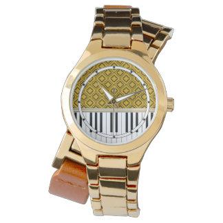 Eleganta pianonycklar med svart Quatrefoil på guld Armbandsur