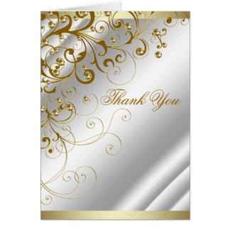 Elegantt elfenbenguld virvlar runt tack OBS kort