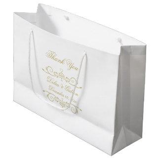 Elegantt vit- och guldMonogramtack