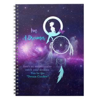 En drömmare anteckningsbok med spiral