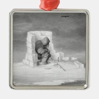 En Eskimaux som håller ögonen på ettHål, från Julgransprydnad Metall