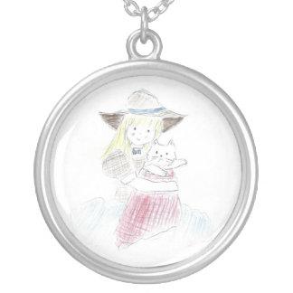 En flicka och henne cat. silverpläterat halsband