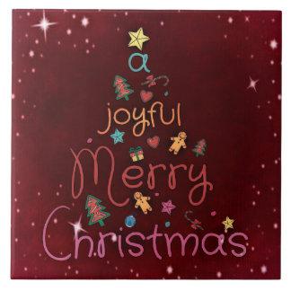 En glatt god julhälsning på rött kakelplatta