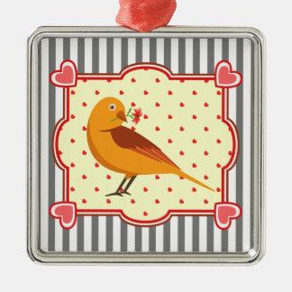 En gullig gul fågel med blomman i en hjärtaram julgransprydnad metall