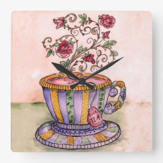 En kopp av rosa Tea tar tid på Fyrkantig Klocka