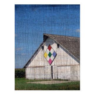 En ladugård med ett täcke vykort
