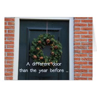 En olik dörr - nytt adress helgdagkort hälsningskort