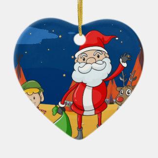 en pojke, en ren och Santa Claus Hjärtformad Julgransprydnad I Keramik