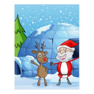 en ren och ett Santa Claus Vykort