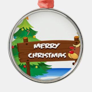 En ren som kramar träsignboarden för christ rund silverfärgad julgransprydnad