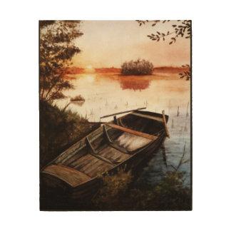 En sjö på solnedgången trätavla