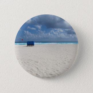 En strandstol väntar på standard knapp rund 5.7 cm
