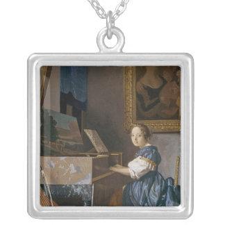 En ung dam som placeras på en Virginal, c.1670 Silverpläterat Halsband