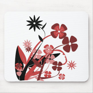 En variation av blommor av olika färger musmatta