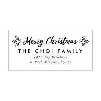 Ett frimärke för bärgod julreturadress stämpel
