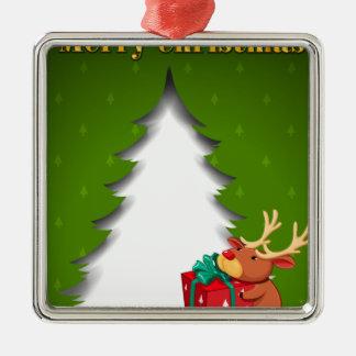 Ett grönt julkort med en ren som kramar ett G Silverfärgad Fyrkantigt Julgransprydnad