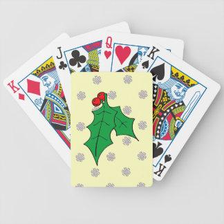 Ett mönster av snöflingor, järnek spelkort