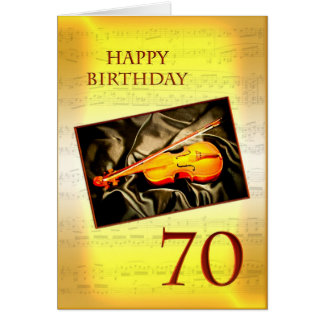 Ett musikaliskt 70th födelsedagkort med en fiol hälsnings kort