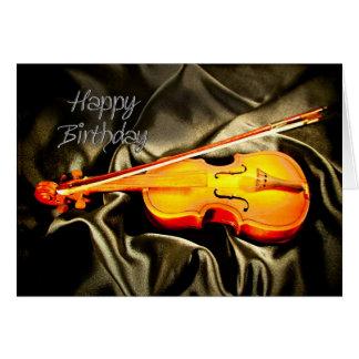 Ett musikaliskt födelsedagkort med en fiol hälsningskort