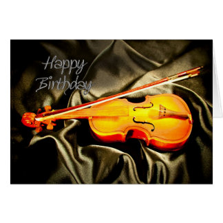Ett musikaliskt födelsedagkort med en fiol kort