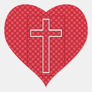 Ett rött kristet kors hjärtformat klistermärke