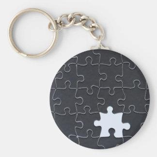 Ett saknat svartvitt pusselbiet rund nyckelring
