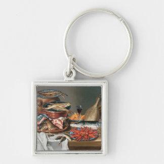 Ett stilleben av hummer för en fisk, forell- och b nyckelring
