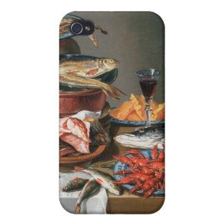 Ett stilleben av hummer för en fisk, forell- och iPhone 4 fodraler