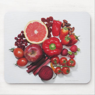 Ett val av röda frukter & vegetables. musmatta
