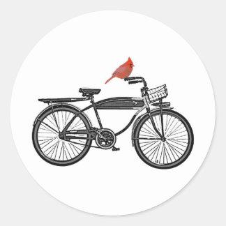 Fågel på en cykel runt klistermärke
